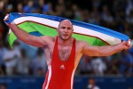 Front – Taymazov's wrestling gold was one, rare bright spot for Team Uzbekistan during the London 2012 Olympic Games. (Photo: Paul Gilham/Getty Images)  Popup – Taymazov's wrestling gold was one, rare bright spot for Team Uzbekistan during the London 2012 Olympic Games. (Photo: Paul Gilham/Getty Images)  Story Page – Waving an Uzbek flag, wrestler Artur Taymazov celebrates a gold medal in the Men's Freestyle 120 kg division at the London 2012 Olympic Games. Uzbekistan's medal tally for the summer games - one gold and three bronzes - fell below expectations by many of the country's sports fans. (Photo: Paul Gilham/Getty Images)