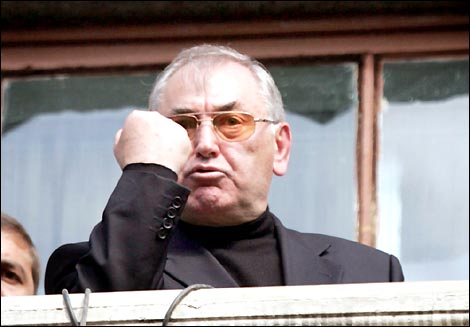 epa000271230 North Ossetian leader Alexander Dzasokhov shakes his fist while speaking during the demonstration in Vladikavkaz, Wednesday 08 September 2004. Alexander Dzasokhov said he was considering resigning and promised to fire the region's government within two days after this rally which blamed last week's school siege in Beslan on the North Ossetian leadership.  EPA/SERGEI CHIRIKOV